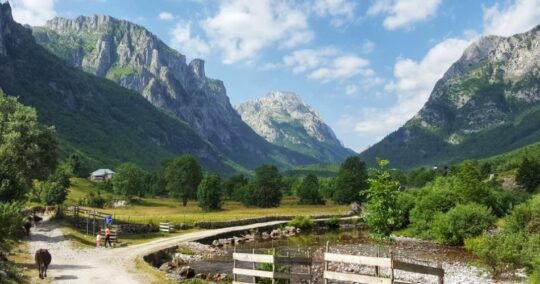 Vuthaj Village with a view of the Accursed Mountains as part of Peaks of the Bakans trail